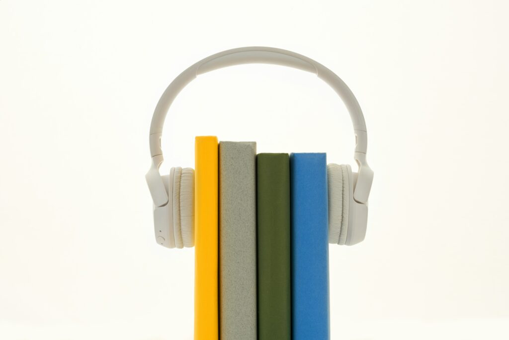 headphones attached to books to signify knowledge